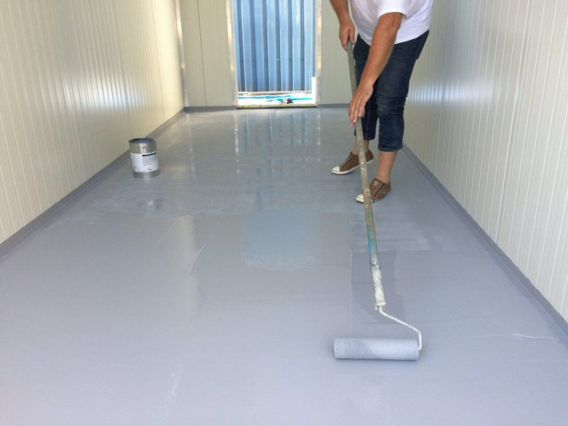 PUROC's QF PUR coating on the wooden floors of containers with desalination equipment